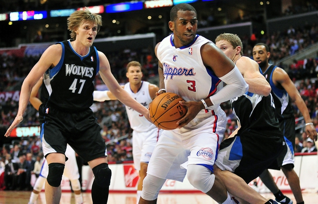 April 10, 2013; Los Angeles, CA, USA; Los Angeles Clippers point guard Chris Paul (3) controls the ball against the defense of Minnesota Timberwolves small forward Andrei Kirilenko (47) during the second half at Staples Center. Mandatory Credit: Gary A. Vasquez-USA TODAY Sports