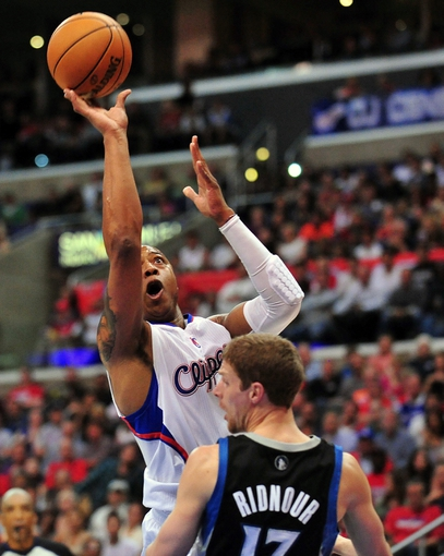 April 10, 2013; Los Angeles, CA, USA; Los Angeles Clippers small forward Caron Butler (5) goes in for a basket against the defense of Minnesota Timberwolves point guard Luke Ridnour (13) during the second half at Staples Center. Mandatory Credit: Gary A. Vasquez-USA TODAY Sports