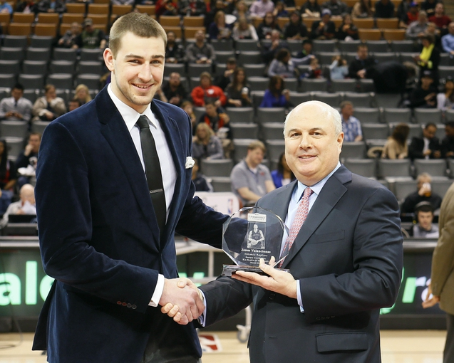 Apr 12, 2013; Toronto, Ontario, CAN; Toronto Raptors center Jonas Valanciunas (left) receives the Eastern Conference Rookie of the Month award from executive vice president of basketball operations Ed Stefanski prior to a game against the Chicago Bulls at the Air Canada Centre. Mandatory Credit: John E. Sokolowski-USA TODAY Sports