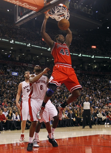 Apr 12, 2013; Toronto, Ontario, CAN; Chicago Bulls center Nazr Mohammed (48) dunks the ball against Toronto Raptors forward-guard Alan Anderson (6) during the first half at the Air Canada Centre. Mandatory Credit: John E. Sokolowski-USA TODAY Sports