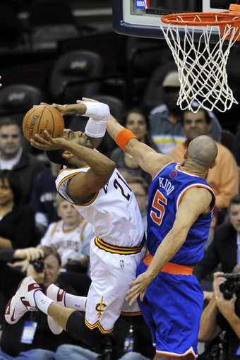 Apr 12, 2013; Cleveland, OH, USA; New York Knicks point guard Jason Kidd (5) defends a shot against Cleveland Cavaliers shooting guard Wayne Ellington (21) in the second quarter at Quicken Loans Arena. Mandatory Credit: David Richard-USA TODAY Sports