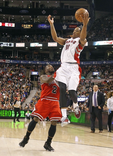Apr 12, 2013; Toronto, Ontario, CAN; Toronto Raptors guard DeMar DeRozan (10) receives a pass over the top of Chicago Bulls guard Nate Robinson (2) during the second half at the Air Canada Centre. Toronto defeated Chicago 97-88. Mandatory Credit: John E. Sokolowski-USA TODAY Sports