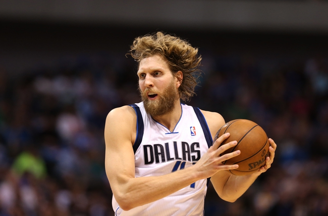 April 12, 2013; Dallas, TX, USA;  Dallas Mavericks forward Dirk Nowitzki (41) in action during the second quarter against the Denver Nuggets at the American Airlines Center. Mandatory Credit: Matthew Emmons-USA TODAY Sports