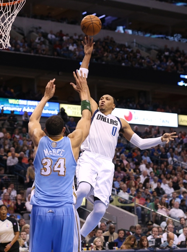 April 12, 2013; Dallas, TX, USA;  Dallas Mavericks forward Shawn Marion (0) shoots during the second quarter against Denver Nuggets center JaVale McGee (34) at the American Airlines Center. Mandatory Credit: Matthew Emmons-USA TODAY Sports
