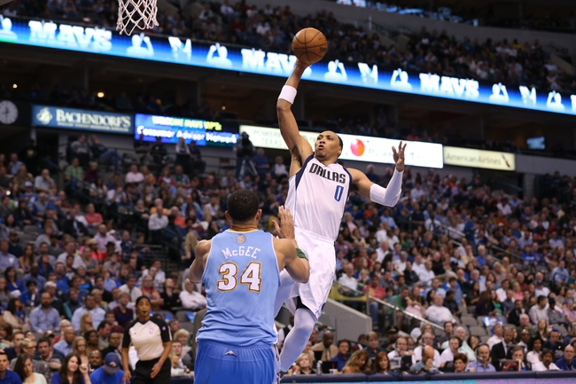 April 12, 2013; Dallas, TX, USA;  Dallas Mavericks forward Shawn Marion (0) shoots during the second quarter against the Denver Nuggets at the American Airlines Center. Mandatory Credit: Matthew Emmons-USA TODAY Sports