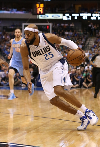 April 12, 2013; Dallas, TX, USA;  Dallas Mavericks guard Vince Carter (25) drives during the second quarter against the Denver Nuggets at the American Airlines Center. Mandatory Credit: Matthew Emmons-USA TODAY Sports