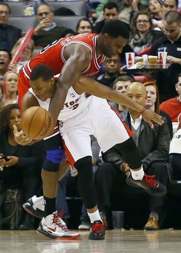 Apr 12, 2013; Toronto, Ontario, CAN; Chicago Bulls center Nazr Mohammed (48) fouls Toronto Raptors guard Kyle Lowry (3) at the Air Canada Centre. Toronto defeated Chicago 97-88. Mandatory Credit: John E. Sokolowski-USA TODAY Sports