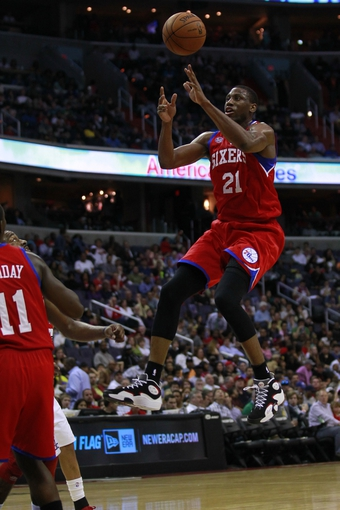 Apr 12, 2013; Washington, DC, USA; Philadelphia 76ers small forward Thaddeus Young (21) loses control of the ball while shooting against the Washington Wizards in the third quarter at Verizon Center. The 76ers won 97-86. Mandatory Credit: Geoff Burke-USA TODAY Sports