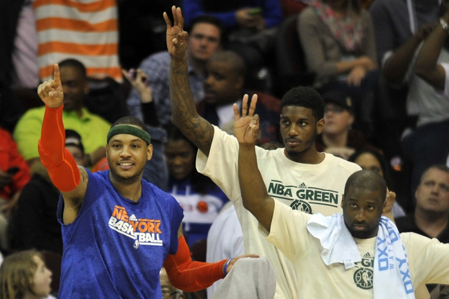 Apr 12, 2013; Cleveland, OH, USA; New York Knicks small forward Carmelo Anthony (left), forward Solomon Jones (center) and point guard Raymond Felton celebrate in the fourth quarter against the Cleveland Cavaliers at Quicken Loans Arena. Mandatory Credit: David Richard-USA TODAY Sports