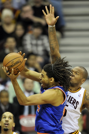 Apr 12, 2013; Cleveland, OH, USA; New York Knicks small forward Chris Copeland (14) drives against Cleveland Cavaliers power forward Marreese Speights (15) in the fourth quarter at Quicken Loans Arena. Mandatory Credit: David Richard-USA TODAY Sports