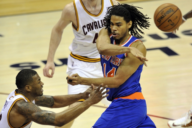 Apr 12, 2013; Cleveland, OH, USA; New York Knicks small forward Chris Copeland (14) makes a no-look pass in the first quarter against the Cleveland Cavaliers at Quicken Loans Arena. Mandatory Credit: David Richard-USA TODAY Sports