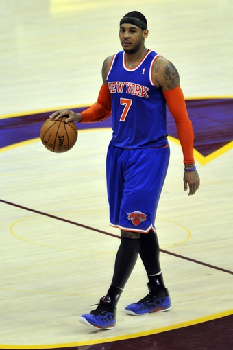 Apr 12, 2013; Cleveland, OH, USA; New York Knicks small forward Carmelo Anthony (7) brings the ball up court in the third quarter against the Cleveland Cavaliers at Quicken Loans Arena. Mandatory Credit: David Richard-USA TODAY Sports