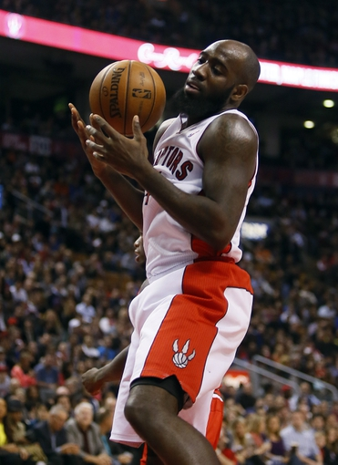 Apr 12, 2013; Toronto, Ontario, CAN; Toronto Raptors forward Quincy Acy (4) gets a rebound against the Chicago Bulls at the Air Canada Centre. Toronto defeated Chicago 97-88. Mandatory Credit: John E. Sokolowski-USA TODAY Sports