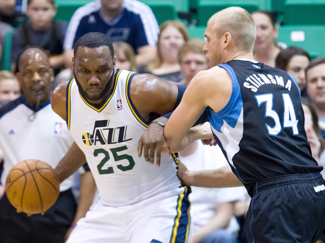 Apr 12, 2013; Salt Lake City, UT, USA; Utah Jazz center Al Jefferson (25) is defended by Minnesota Timberwolves center Greg Stiemsma (34) during the first half at EnergySolutions Arena. Mandatory Credit: Russ Isabella-USA TODAY Sports