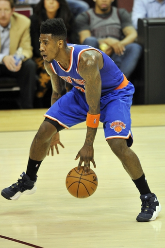 Apr 12, 2013; Cleveland, OH, USA; New York Knicks small forward Iman Shumpert (21) dribbles the ball between his legs in the fourth quarter against the Cleveland Cavaliers at Quicken Loans Arena. Mandatory Credit: David Richard-USA TODAY Sports