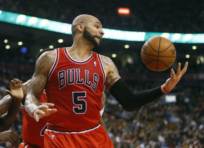 Apr 12, 2013; Toronto, Ontario, CAN; Chicago Bulls forward Carlos Boozer (5) gets a rebound against the Toronto Raptors at the Air Canada Centre. Toronto defeated Chicago 97-88. Mandatory Credit: John E. Sokolowski-USA TODAY Sports