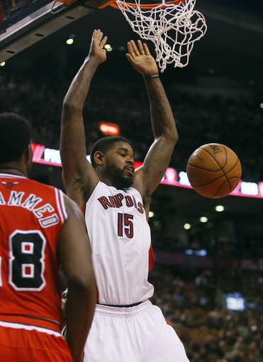 Apr 12, 2013; Toronto, Ontario, CAN; Toronto Raptors center-forward Amir Johnson (15) dunks against Chicago Bulls center Nazr Mohammed (48) at the Air Canada Centre. Toronto defeated Chicago 97-88. Mandatory Credit: John E. Sokolowski-USA TODAY Sports