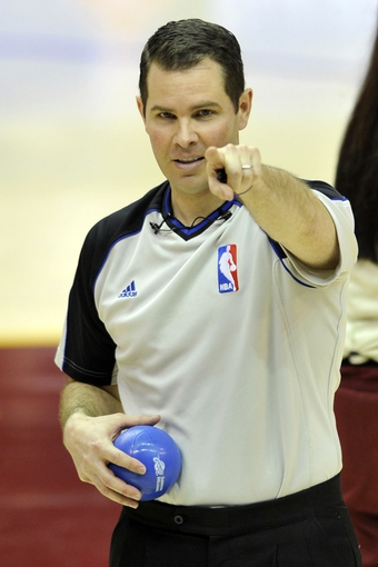Apr 12, 2013; Cleveland, OH, USA; NBA referee Brian Forte (45) points to fan during a timeout of a game between the Cleveland Cavaliers and the New York Knicks at Quicken Loans Arena. Mandatory Credit: David Richard-USA TODAY Sports
