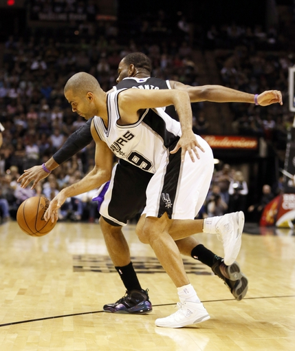 Apr 12, 2013; San Antonio, TX, USA; Sacramento Kings guard Marcus Thornton (behind) has the ball stolen by San Antonio Spurs guard Tony Parker (front) during the second half at the AT&T Center. The Spurs won 108-101. Mandatory Credit: Soobum Im-USA TODAY Sports