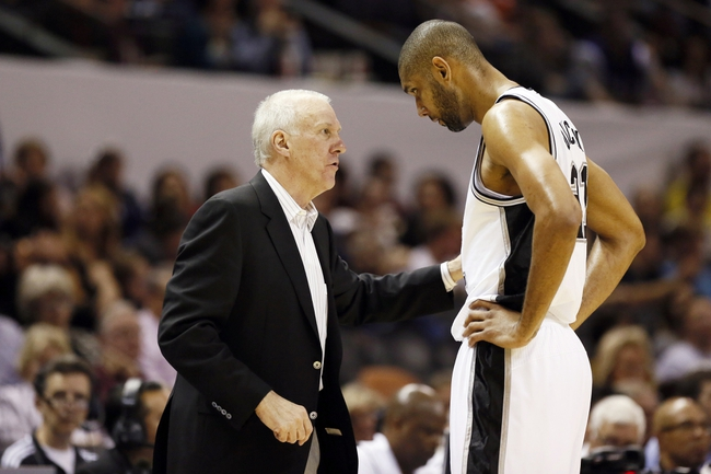 Apr 12, 2013; San Antonio, TX, USA; San Antonio Spurs head coach Gregg Popovich talks to Tim Duncan (21) during the second half against the Sacramento Kings at the AT&T Center. The Spurs won 108-101. Mandatory Credit: Soobum Im-USA TODAY Sports