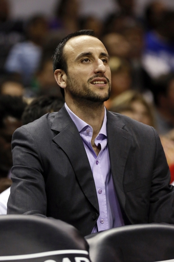 Apr 12, 2013; San Antonio, TX, USA; San Antonio Spurs guard Manu Ginobili (20) watches from the bench during the first half against the Sacramento Kings at the AT&T Center. Mandatory Credit: Soobum Im-USA TODAY Sports