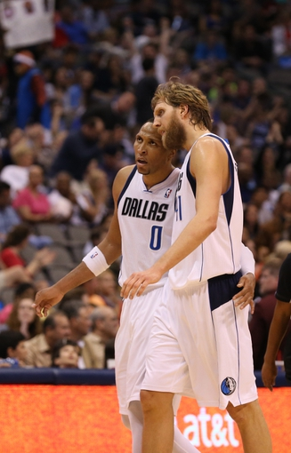 April 12, 2013; Dallas, TX, USA;  Dallas Mavericks forward Shawn Marion (0)  reacts with forward Dirk Nowitzki (41) as they walk to the bench during a timeout against the Denver Nuggets at the American Airlines Center. The Mavs beat the Nuggets 108-105 in overtime. Mandatory Credit: Matthew Emmons-USA TODAY Sports