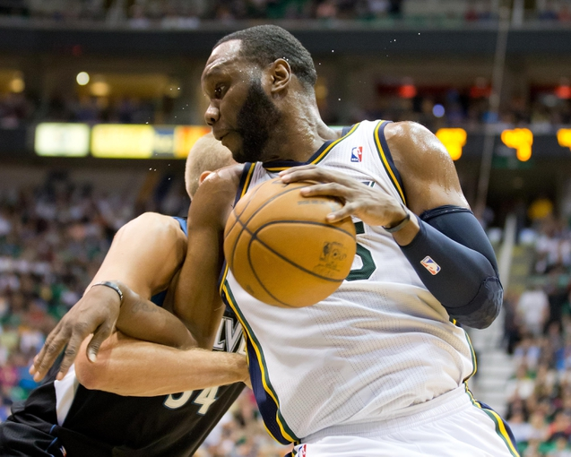 Apr 12, 2013; Salt Lake City, UT, USA; Utah Jazz center Al Jefferson (25) is defended by Minnesota Timberwolves center Greg Stiemsma (34) during the second half at EnergySolutions Arena. The Jazz won 107-100. Mandatory Credit: Russ Isabella-USA TODAY Sports