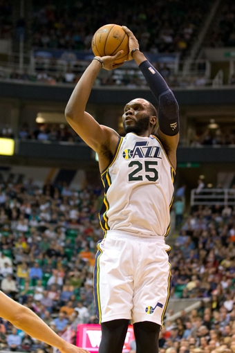 Apr 12, 2013; Salt Lake City, UT, USA; Utah Jazz center Al Jefferson (25) shoots during the second half against the Minnesota Timberwolves at EnergySolutions Arena. The Jazz won 107-100. Mandatory Credit: Russ Isabella-USA TODAY Sports