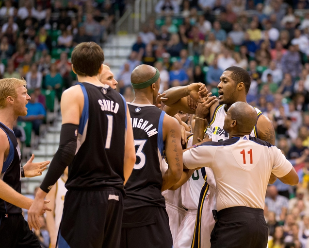 Apr 12, 2013; Salt Lake City, UT, USA; Utah Jazz power forward Derrick Favors (15) is separated from Minnesota Timberwolves players after flagrantly fouling point guard J.J. Barea (not pictured) during the second half at EnergySolutions Arena. The Jazz won 107-100. Mandatory Credit: Russ Isabella-USA TODAY Sports