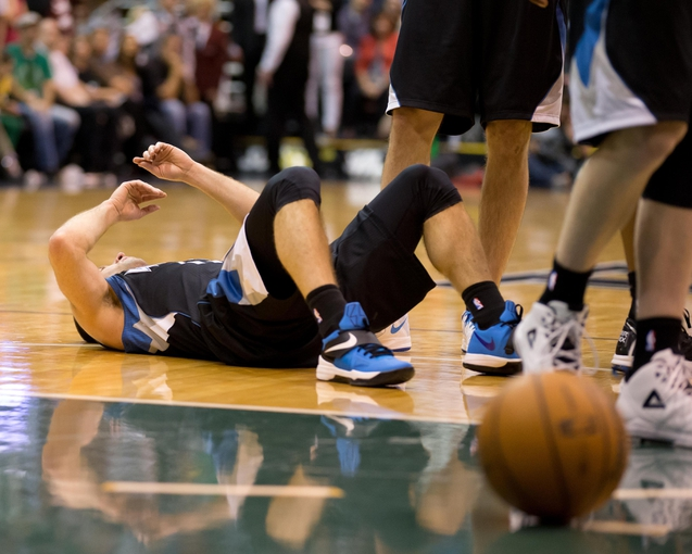 Apr 12, 2013; Salt Lake City, UT, USA; Minnesota Timberwolves point guard J.J. Barea (11) lies on the court after being flagrantly fouled by Utah Jazz power forward Derrick Favors (not pictured) during the second half at EnergySolutions Arena. The Jazz won 107-100. Mandatory Credit: Russ Isabella-USA TODAY Sports
