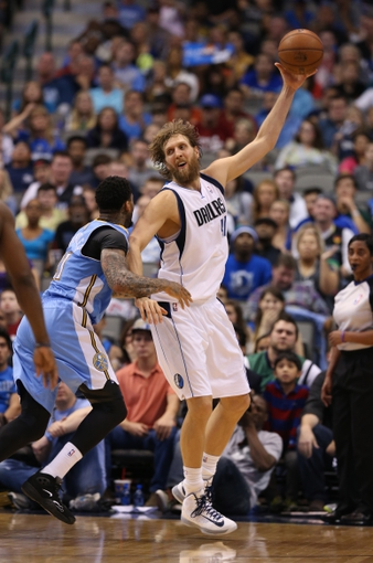 April 12, 2013; Dallas, TX, USA;  Dallas Mavericks forward Dirk Nowitzki (41) in the post in overtime against Denver Nuggets forward Wilson Chandler (21) at the American Airlines Center. April 12, 2013; Dallas, TX, USA;  Dallas Mavericks guard Vince Carter (25) celebrates a basket in overtime against the Denver Nuggets at the American Airlines Center. The Mavs beat the Nuggets 108-105 in overtime. Mandatory Credit: Matthew Emmons-USA TODAY Sports