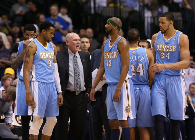 April 12, 2013; Dallas, TX, USA; Denver Nuggets head coach George Karl talks with his team during a timeout against the Dallas Mavericks at the American Airlines Center. The Mavs beat the Nuggets 108-105 in overtime. Mandatory Credit: Matthew Emmons-USA TODAY Sports