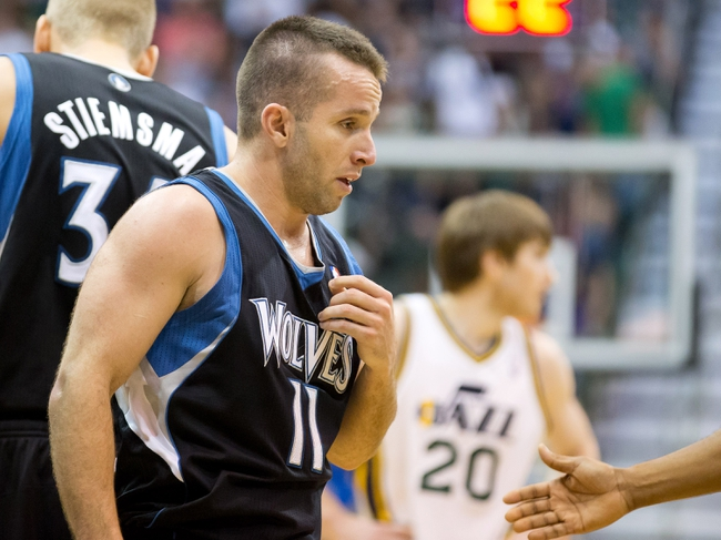 Apr 12, 2013; Salt Lake City, UT, USA; Minnesota Timberwolves point guard J.J. Barea (11) leaves the court after being flagrantly fouled during the second half against the Utah Jazz at EnergySolutions Arena. The Jazz won 107-100. Mandatory Credit: Russ Isabella-USA TODAY Sports