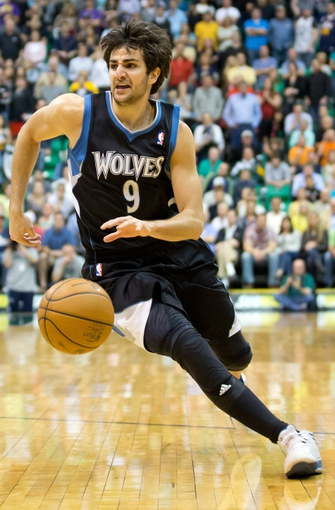 Apr 12, 2013; Salt Lake City, UT, USA; Minnesota Timberwolves point guard Ricky Rubio (9) drives to the basket during the second half against the Utah Jazz at EnergySolutions Arena. The Jazz won 107-100. Mandatory Credit: Russ Isabella-USA TODAY Sports