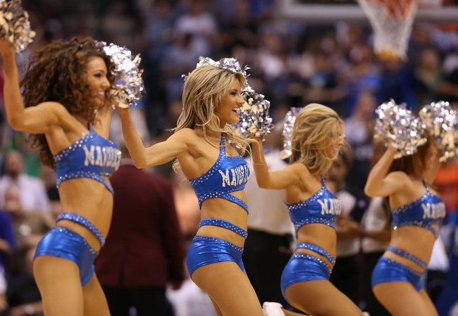 April 12, 2013; Dallas, TX, USA;  Dallas Mavericks dancer performs during a timeout against the Denver Nuggets at the American Airlines Center. The Mavs beat the Nuggets 108-105 in overtime. Mandatory Credit: Matthew Emmons-USA TODAY Sports
