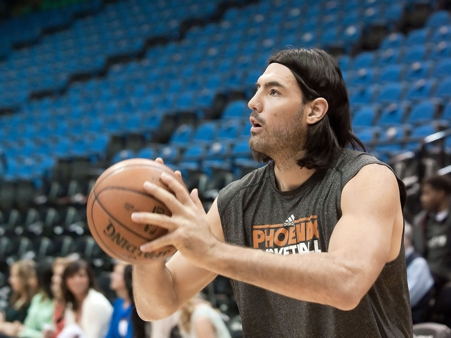 Apr 13, 2013; Minneapolis, MN, USA; Phoenix Suns power forward Luis Scola (14) warms up before playing the Minnesota Timberwolves at Target Center. Mandatory Credit:  Greg Smith-USA TODAY Sports