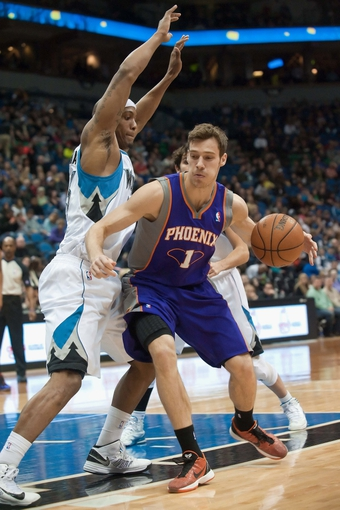 Apr 13, 2013; Minneapolis, MN, USA; Phoenix Suns point guard Goran Dragic (1) dribbles as Minnesota Timberwolves power forward Dante Cunningham (33) defends in the first quarter at Target Center. Mandatory Credit:  Greg Smith-USA TODAY Sports