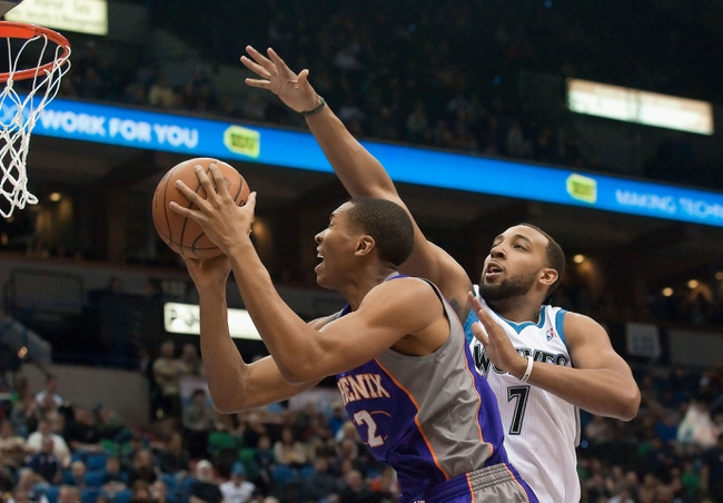 Apr 13, 2013; Minneapolis, MN, USA; Phoenix Suns small forward Wesley Johnson (2) shoots as Minnesota Timberwolves power forward Derrick Williams (7) defends in the first quarter at Target Center. Mandatory Credit:  Greg Smith-USA TODAY Sports