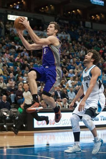 Apr 13, 2013; Minneapolis, MN, USA; Phoenix Suns point guard Goran Dragic (1) drives to the basket past Minnesota Timberwolves point guard Ricky Rubio (9) in the first quarter at Target Center. Mandatory Credit:  Greg Smith-USA TODAY Sports