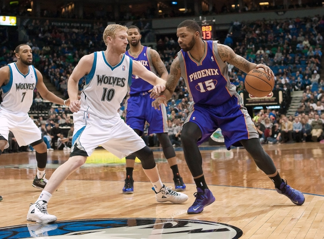Apr 13, 2013; Minneapolis, MN, USA; Phoenix Suns power forward Marcus Morris (15) dribbles as Minnesota Timberwolves small forward Chase Budinger (10) defends during the second quarter at the Target Center. Mandatory Credit:  Greg Smith-USA TODAY Sports