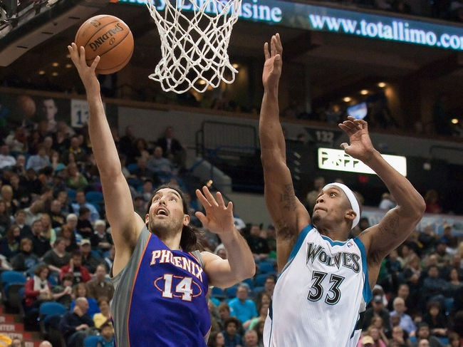 Apr 13, 2013; Minneapolis, MN, USA; Phoenix Suns power forward Luis Scola (14) shoots as Minnesota Timberwolves power forward Dante Cunningham (33) defends in the second quarter at the Target Center. Mandatory Credit:  Greg Smith-USA TODAY Sports