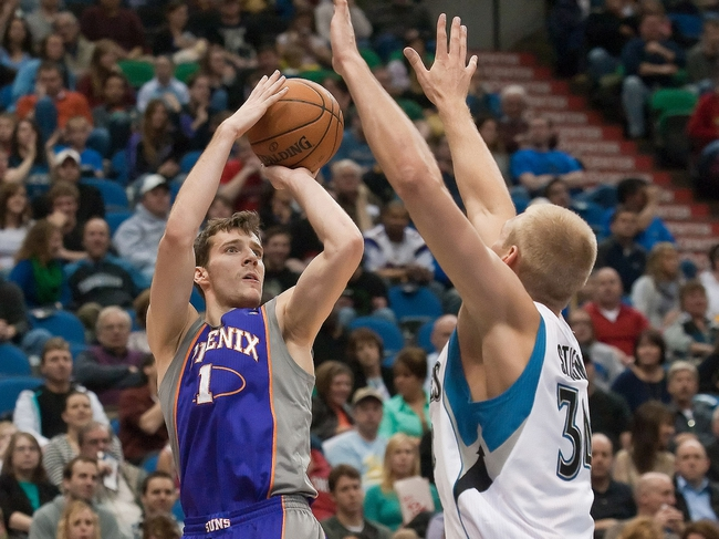 Apr 13, 2013; Minneapolis, MN, USA; Phoenix Suns point guard Goran Dragic (1) shoots as Minnesota Timberwolves center Greg Stiemsma (34) defends during the second quarter at the Target Center. Mandatory Credit:  Greg Smith-USA TODAY Sports