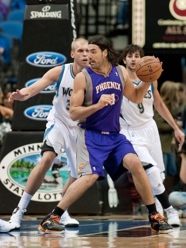 Apr 13, 2013; Minneapolis, MN, USA; Minnesota Timberwolves center Greg Stiemsma (34) defends Phoenix Suns power forward Luis Scola (14) in the fourth quarter at the Target Center. Timberwolves won 105-93. Mandatory Credit:  Greg Smith-USA TODAY Sports