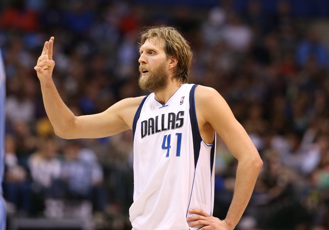April 12, 2013; Dallas, TX, USA;  Dallas Mavericks forward Dirk Nowitzki (41) reacts during the second quarter against the Denver Nuggets at the American Airlines Center. Mandatory Credit: Matthew Emmons-USA TODAY Sports