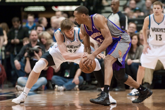 Apr 13, 2013; Minneapolis, MN, USA; Minnesota Timberwolves small forward Andrei Kirilenko (47) attempts to steal the ball from Phoenix Suns small forward Wesley Johnson (2) during the fourth quarter at the Target Center. Timberwolves won 105-93. Mandatory Credit:  Greg Smith-USA TODAY Sports