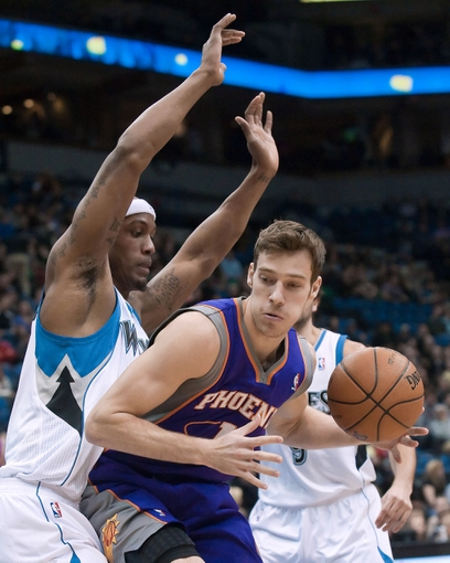 Apr 13, 2013; Minneapolis, MN, USA; Phoenix Suns point guard Goran Dragic (1) drives to the basket as he is defended by Minnesota Timberwolves power forward Dante Cunningham (33) in the second quarter at the Target Center. Timberwolves won 105-93. Mandatory Credit:  Greg Smith-USA TODAY Sports