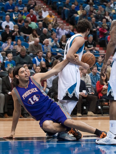 Apr 13, 2013; Minneapolis, MN, USA; Phoenix Suns power forward Luis Scola (14) gets tangled up with Minnesota Timberwolves point guard Ricky Rubio (9) in the second quarter at the Target Center. Timberwolves won 105-93. Mandatory Credit:  Greg Smith-USA TODAY Sports