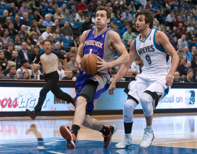Apr 13, 2013; Minneapolis, MN, USA; Phoenix Suns point guard Goran Dragic (1) drives to the basket as he is defended by Minnesota Timberwolves point guard Ricky Rubio (9) in the first quarter at the Target Center. Timberwolves won 105-93. Mandatory Credit:  Greg Smith-USA TODAY Sports