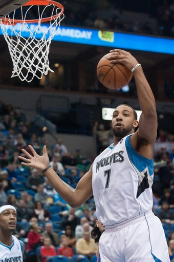 Apr 13, 2013; Minneapolis, MN, USA; Minnesota Timberwolves power forward Derrick Williams (7) grabs a rebound in the second quarter against the Phoenix Suns at the Target Center. Timberwolves won 105-93. Mandatory Credit:  Greg Smith-USA TODAY Sports