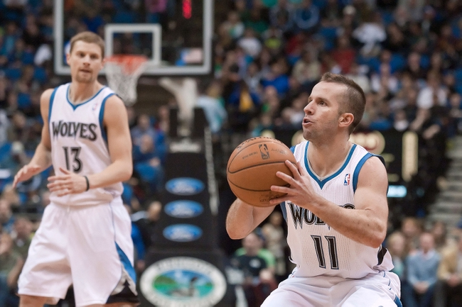Apr 13, 2013; Minneapolis, MN, USA; Minnesota Timberwolves point guard J.J. Barea (11) shoots against the Phoenix Suns during the fourth quarter at the Target Center. Timberwolves won 105-93. Mandatory Credit:  Greg Smith-USA TODAY Sports